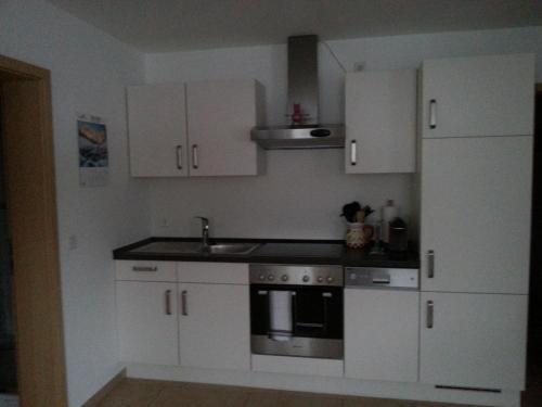 Küche/Küchenzeile in der Unterkunft Ferienwohnung Ohmeis