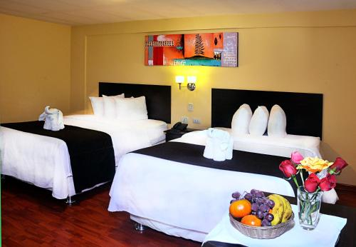 A bed or beds in a room at Casona Hotel Centro