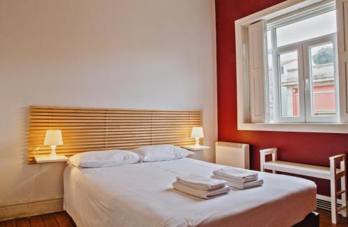 A bed or beds in a room at Porto Spot Hostel