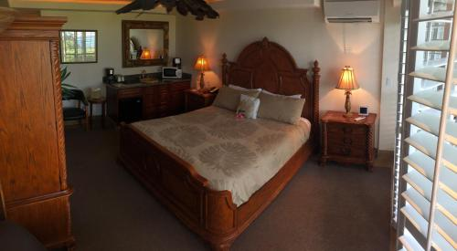 A bed or beds in a room at Hotel Coral Reef