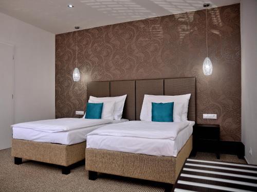 Кровать или кровати в номере Hotel Atrium