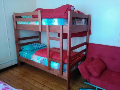 A bunk bed or bunk beds in a room at Hostal Dundo Ivo Spa