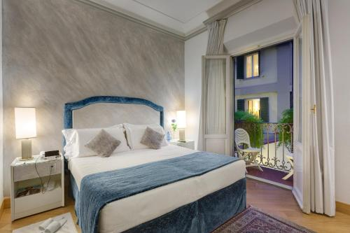 A bed or beds in a room at Rivoli Boutique Hotel