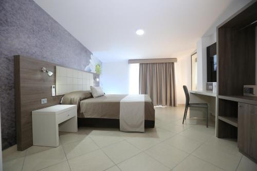 Letto o letti in una camera di Medea Resort
