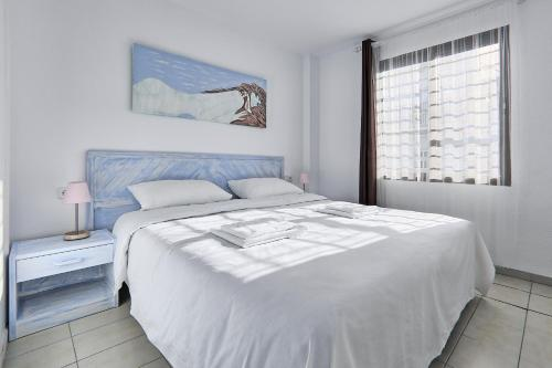 A bed or beds in a room at All Suite Ibiza Aparthotel