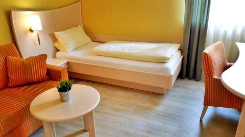 Ein Bett oder Betten in einem Zimmer der Unterkunft Landgasthof Zum Stern