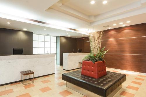 A television and/or entertainment center at HOTEL MYSTAYS Sakaisuji Honmachi