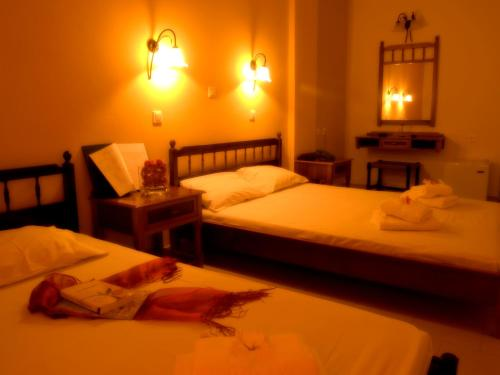A bed or beds in a room at Kissamos Hotel