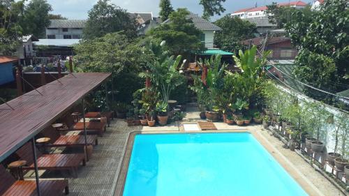 A view of the pool at Baan Tebpitak Elegant Ayotthaya or nearby