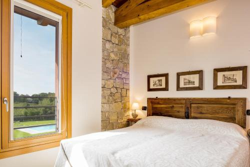 A bed or beds in a room at Rovertondo