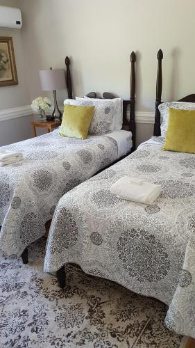 A bed or beds in a room at Boscawen Inn