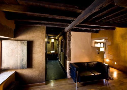 A seating area at Hotel El Convento de Mave