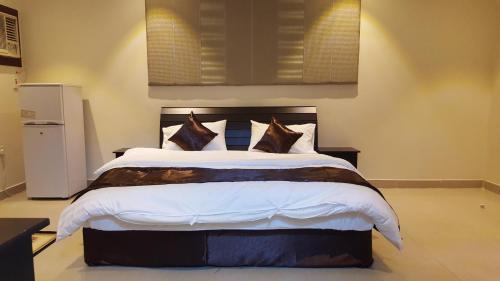 Cama ou camas em um quarto em أجنحة العليان