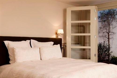 Een bed of bedden in een kamer bij @Couche Couche