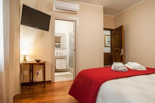 A bed or beds in a room at Villa Olga B&B