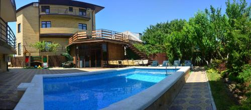 The swimming pool at or near Guest house Vostok