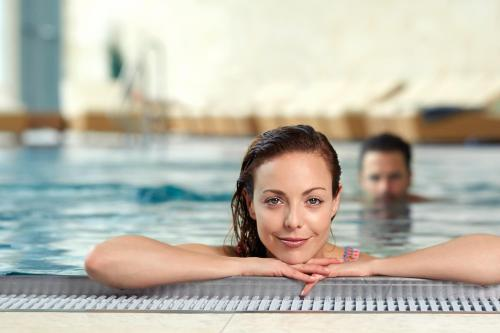 The swimming pool at or near Therme Laa - Hotel & Silent Spa