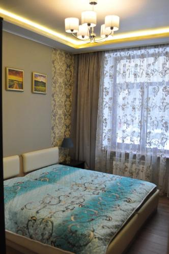 A bed or beds in a room at Zanevsky guest house
