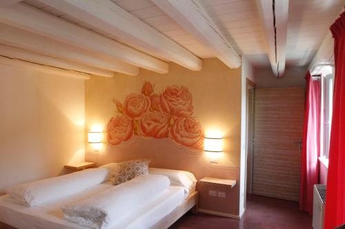 A bed or beds in a room at Dormire alla Ruota