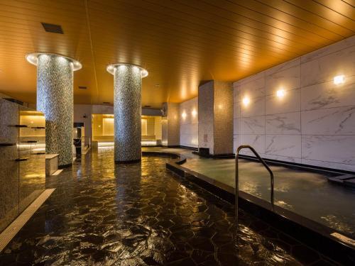 The swimming pool at or near APA Hotel & Resort Tokyo Bay Makuhari