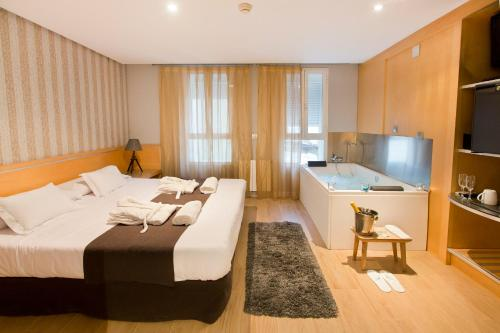 Cama o camas de una habitación en YOU & CO. J. Botánico Boutique
