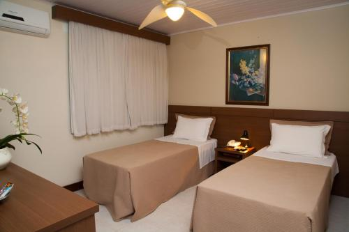 A bed or beds in a room at Príncipe Hotel