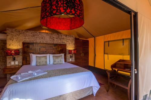 A bed or beds in a room at Serenity Luxury Glamping Riviera Tulum
