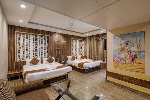 A bed or beds in a room at The Royal Melange Beacon