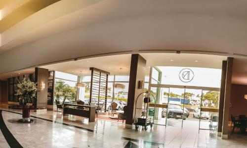 Um restaurante ou outro lugar para comer em Hotel Dunamys