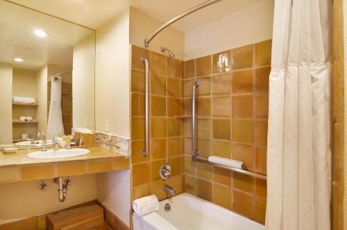 A bathroom at Cypress Inn on Miramar Beach