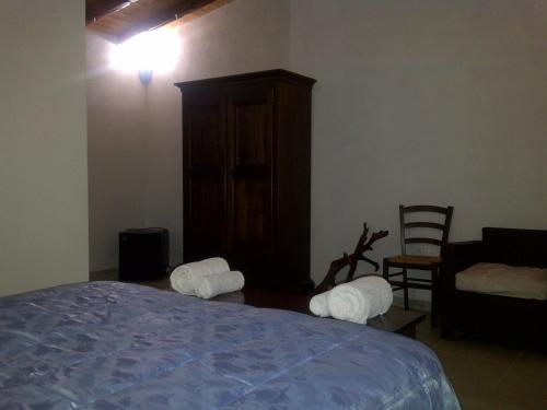 A bed or beds in a room at Agriturismo La Quercia