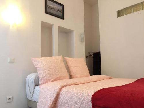 A bed or beds in a room at Appartement Euromed - Les Docks