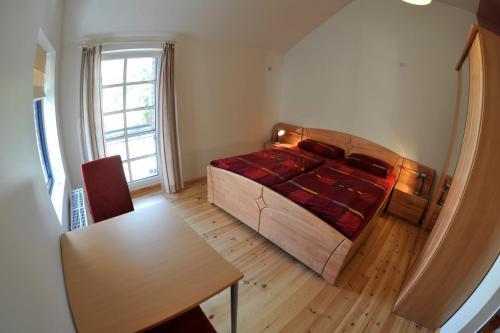 A bed or beds in a room at Hof Märkische Heide