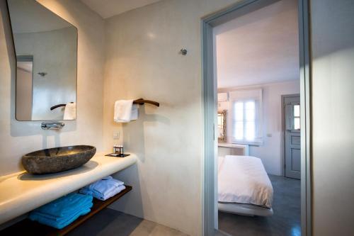 A bathroom at Blue Sand Boutique Hotel & Suites