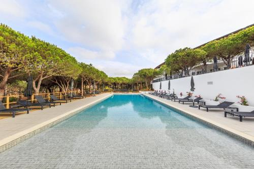 The swimming pool at or near Praia Verde Boutique Hotel