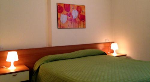 A bed or beds in a room at Green Village Accommodations