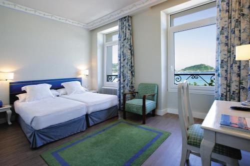 Cama o camas de una habitación en Hotel Niza