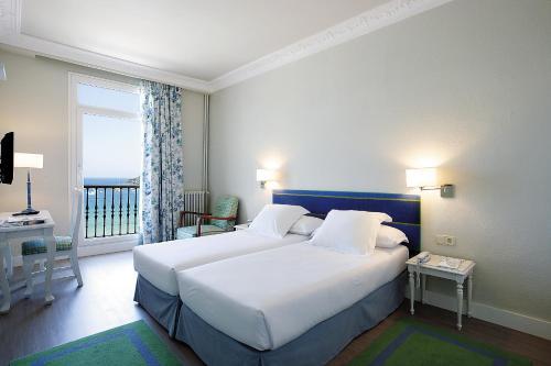 Een bed of bedden in een kamer bij Hotel Niza