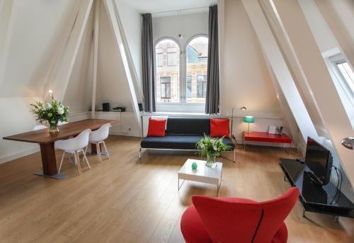 Een zitgedeelte bij Loft 6 kingsize apartment 2-4persons with great kitchen