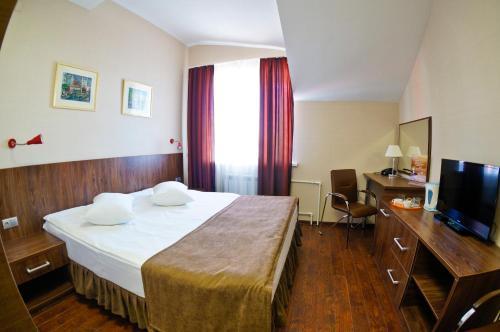 Кровать или кровати в номере Гостиница Рябинка