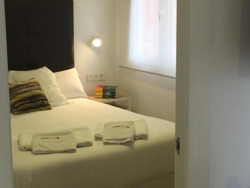Säng eller sängar i ett rum på Málaga Andes