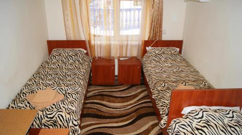 Кровать или кровати в номере База Отдыха Солнечный Берег