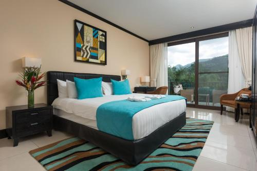A bed or beds in a room at The Royal Corin Thermal Water Spa & Resort - Adults Only