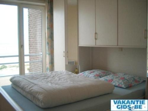 Ein Bett oder Betten in einem Zimmer der Unterkunft Residence Scorpio