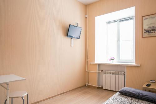 Телевизор и/или развлекательный центр в Flat76 Volzhskaya Naberezhnaya 61