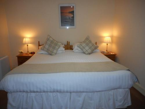 A bed or beds in a room at The Robertson Arms Hotel