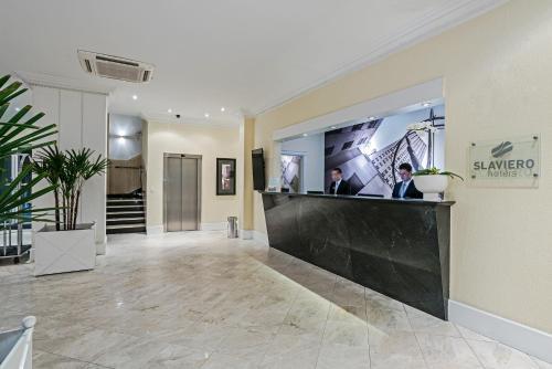 The lobby or reception area at ROCKEFELLER by Slaviero Hotéis