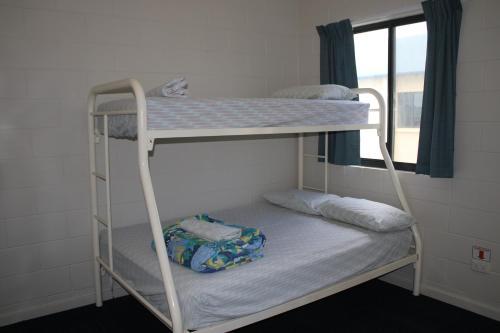 A bunk bed or bunk beds in a room at Ningaloo Coral Bay Backpackers