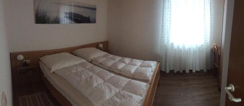 Ein Bett oder Betten in einem Zimmer der Unterkunft Ferienhäuser Schlossberg
