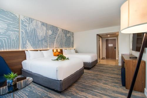 A bed or beds in a room at B Ocean Resort